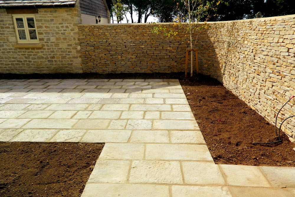 Flagstone patio and Cotswold stone wall