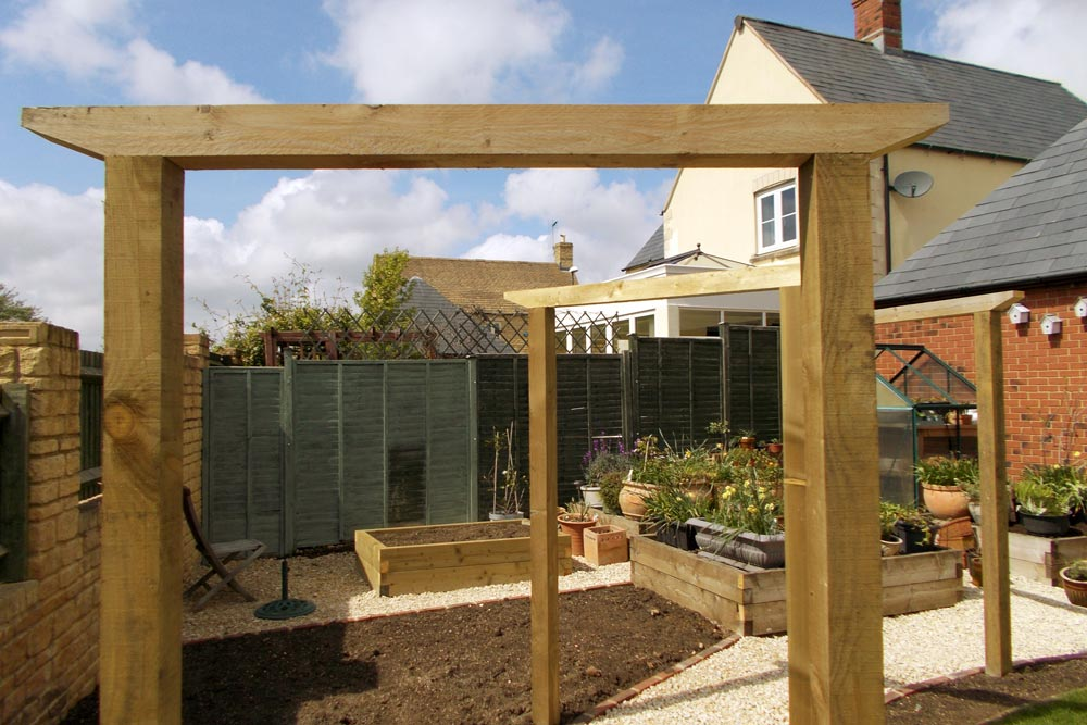 Garden pergola and raised beds