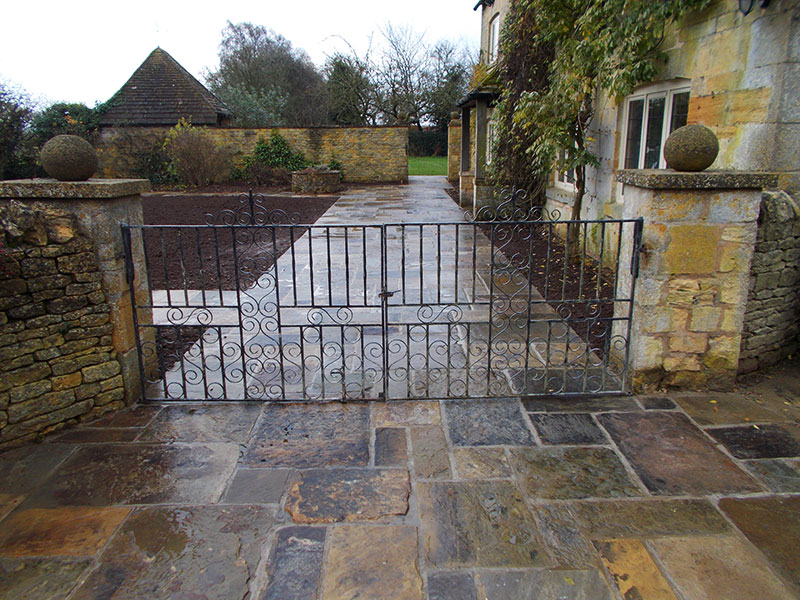 Reclaimed York Paving patio and gates by Dan Groves Contracting